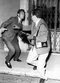 """Scene from federico fellini`s """"La Dolce Vita"""" where the persistent press photographer named Paparazzo is beaten in defense Copyright: Società Dante Alighieri, Roma"""