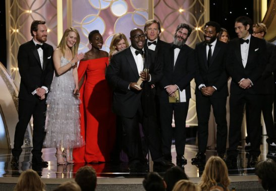 """Best Motion Picture - Drama Steve McQueen, center, accepting the award for best motion picture drama for """"12 Years a Slave"""" during the 71st annual Golden Globe Awards at the Beverly Hilton Hotel on Sunday, Jan. 12, 2014, in Beverly Hills. Image Copyright courtesy 2014 , Paul Drinkwater 